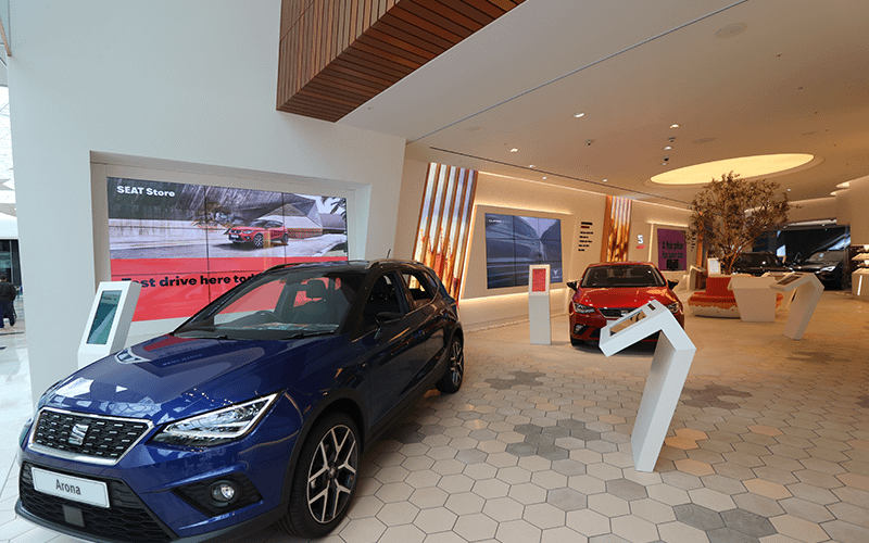 Seat car showroom with multiple types of digital signage