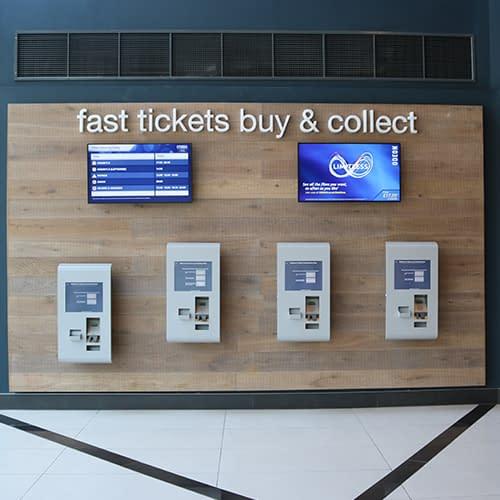 Diigital signage screens and self-service kiosks at a UK cinema