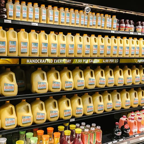 InstoreScreen shelf-edge digital signage displaying orange juice product prices