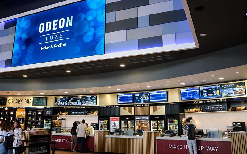 A video wall and digital signage menu boards at a UK cinema