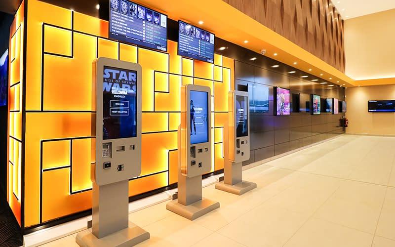 Self-service freestanding ticket kiosks at a UK cinema
