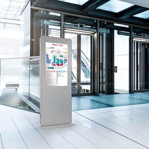 Wayfinding digital signage totem in a lobby