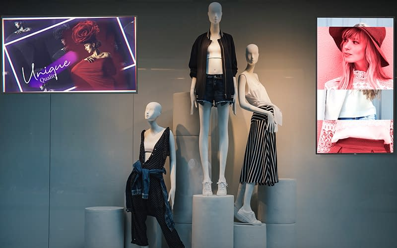 NEC high bright digital signage screens in the window of a clothing retail store