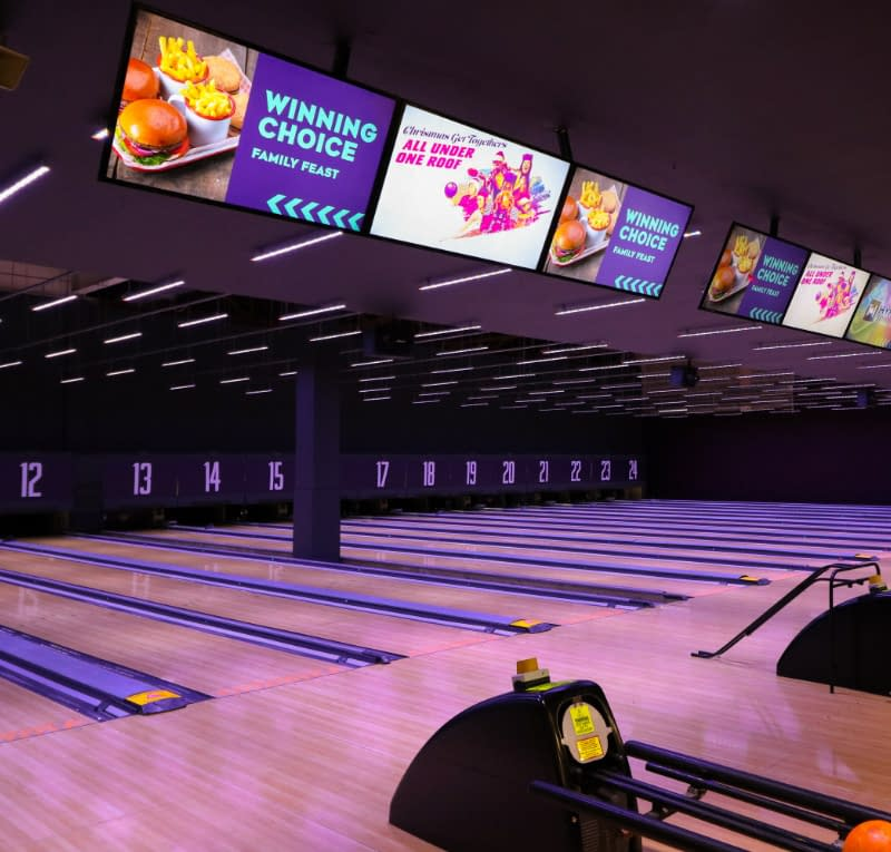 Digital signage used at a bowling alley to promote food and drink promotions