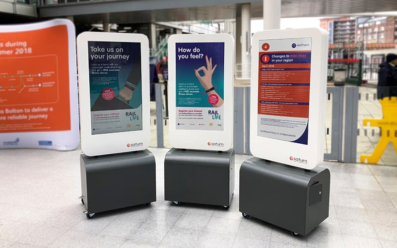 Mobile digital signage totems at a Manchester train station