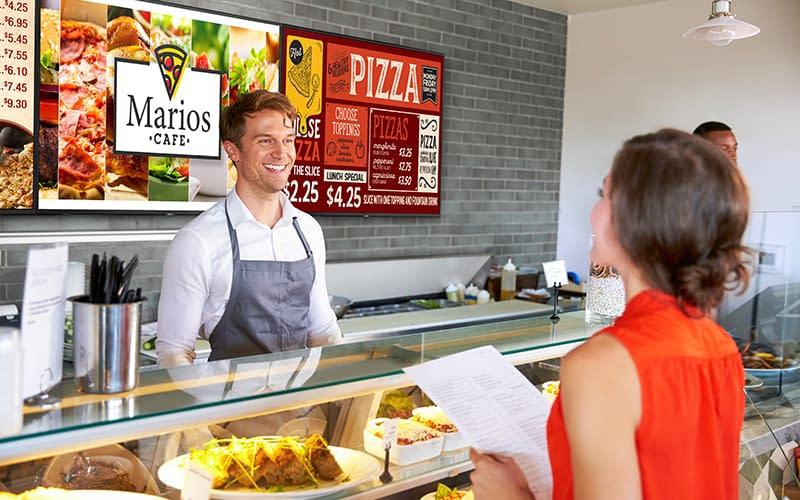 NEC menu board digital signage in a pizza fast food restaurant