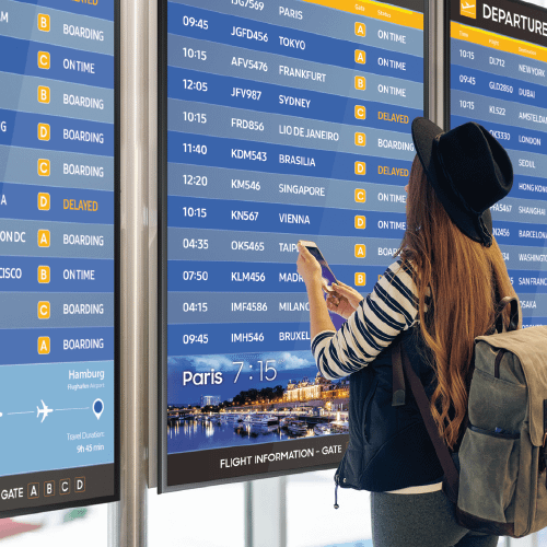 Passenger in an airport using digital signage to find information