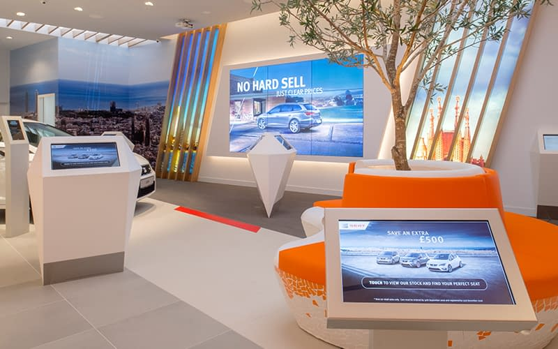 Multiple types of digital signage at a SEAT car showroom in the UK