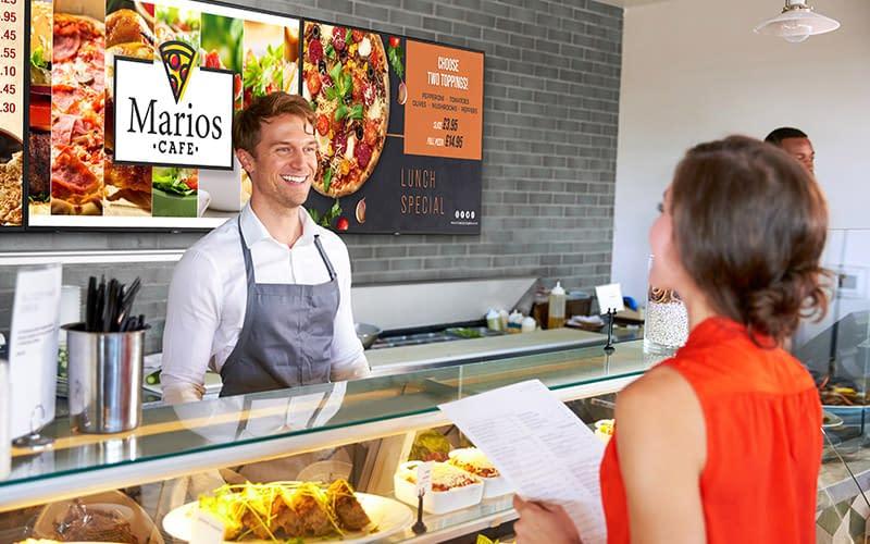 NEC M Series digital signage screen used in a cafe as a menu board