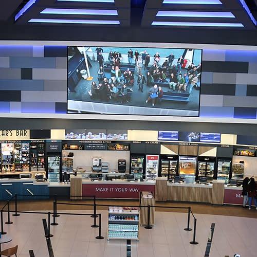 Menu boards and digital signage screen in a cinema foyer