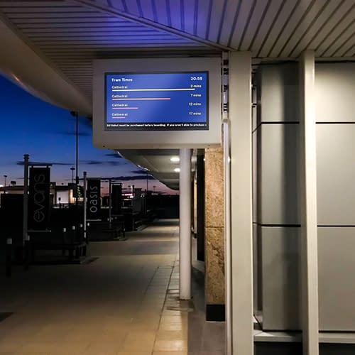 Digital sign displaying timetable information on a train platform