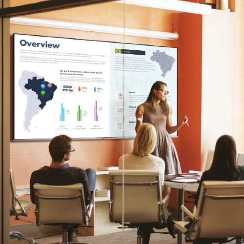 Woman using digital signage to present corporate information